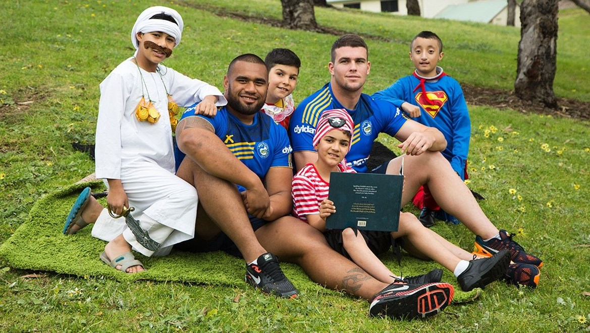 Dyldam Parramatta Eels Junior Paulo and Darcy Lussick with students from the Eels Educate program during Book Week