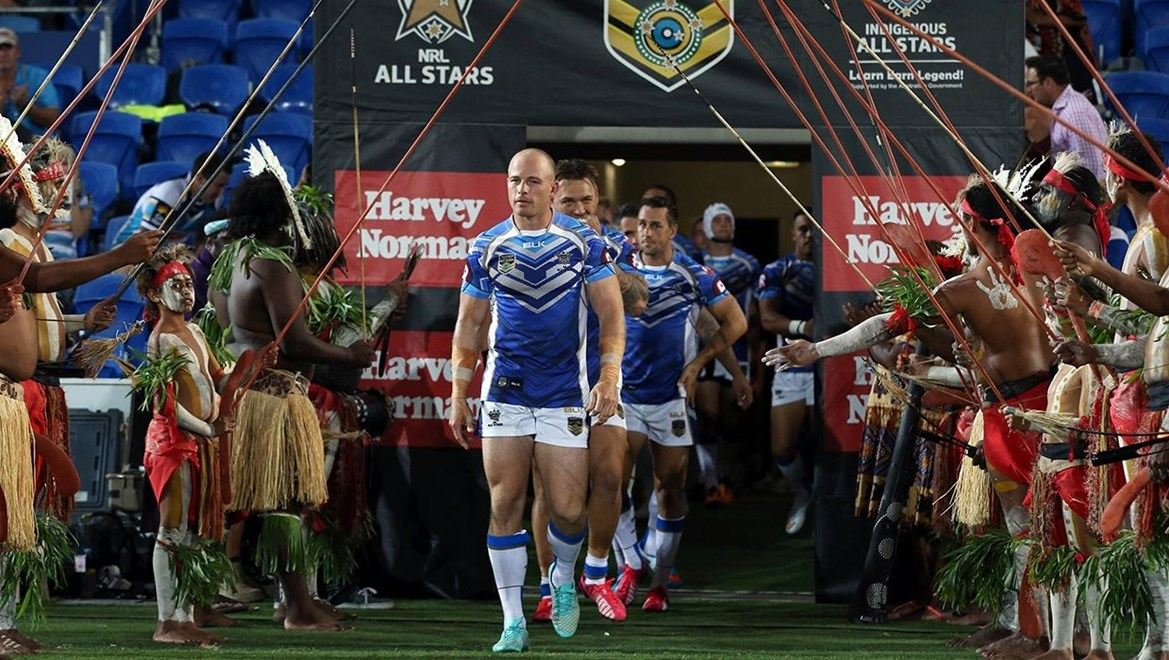 Beau Scott leads the NRL Allstars onto the field : Digital Image by Robb Cox ©nrlphotos.com:  :NRL Rugby League - Indigenous All Stars Vs NRL All Stars,  at CBUS Stadium, Friday February 13th 2015.