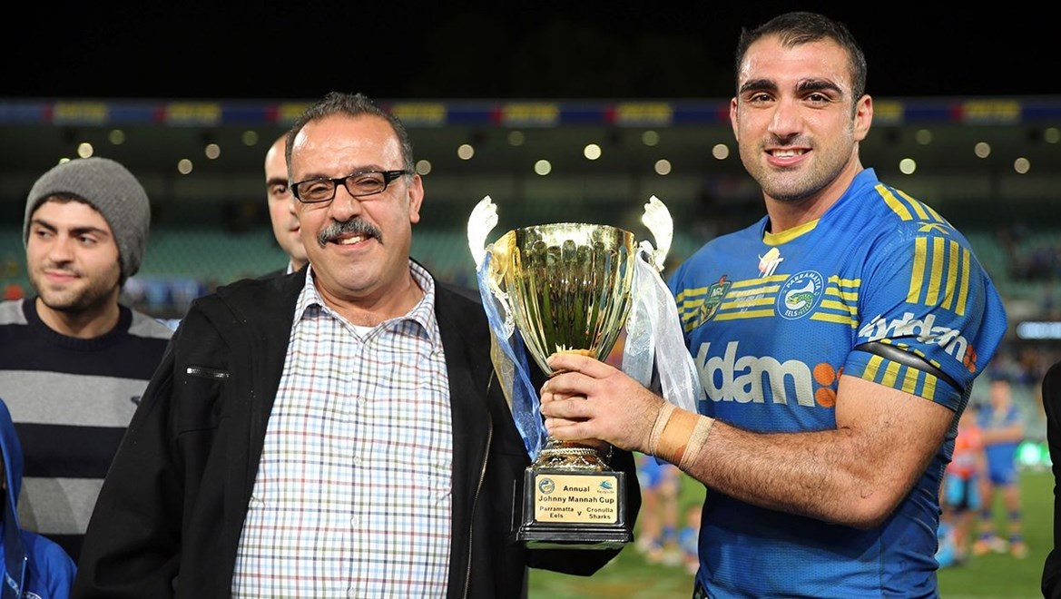 Tim Mannah holds the Johnny Mannah Cup with his Dad. Photo by Grant Trouville © nrlphotos.com